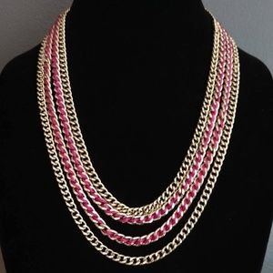 Layered silver chain necklace with magenta accent